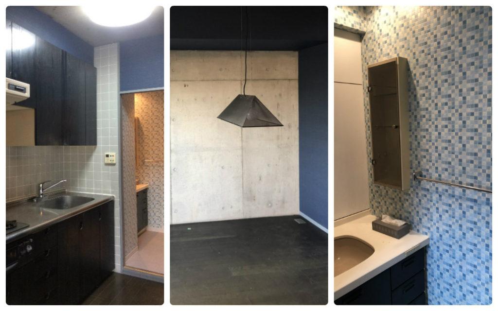 打ちっぱなしと紺の壁紙が特徴の室内とキッチン廻り